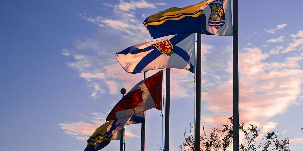 Nova Scotia flag waving in the wind at dusk by Halifax Harbour.